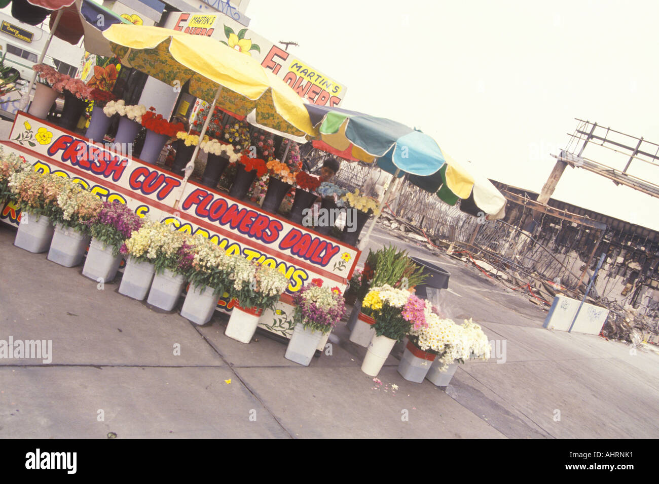 Flower stand in front of business destroyed by riots South Central Los Angeles California - Stock Image