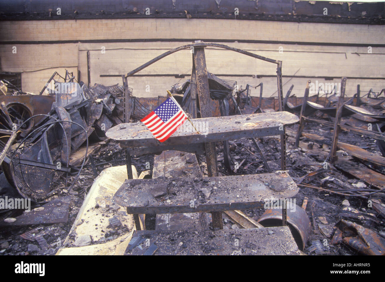 Small American flag at site of 1992 riots South Central Los Angeles California - Stock Image