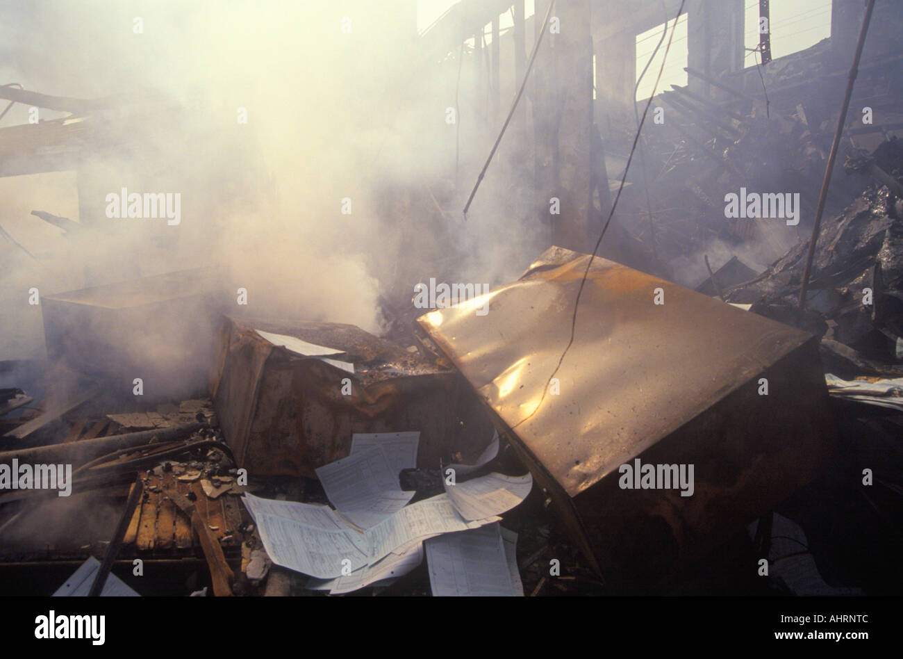 Smoldering business after 1992 riots South Central Los Angeles California - Stock Image