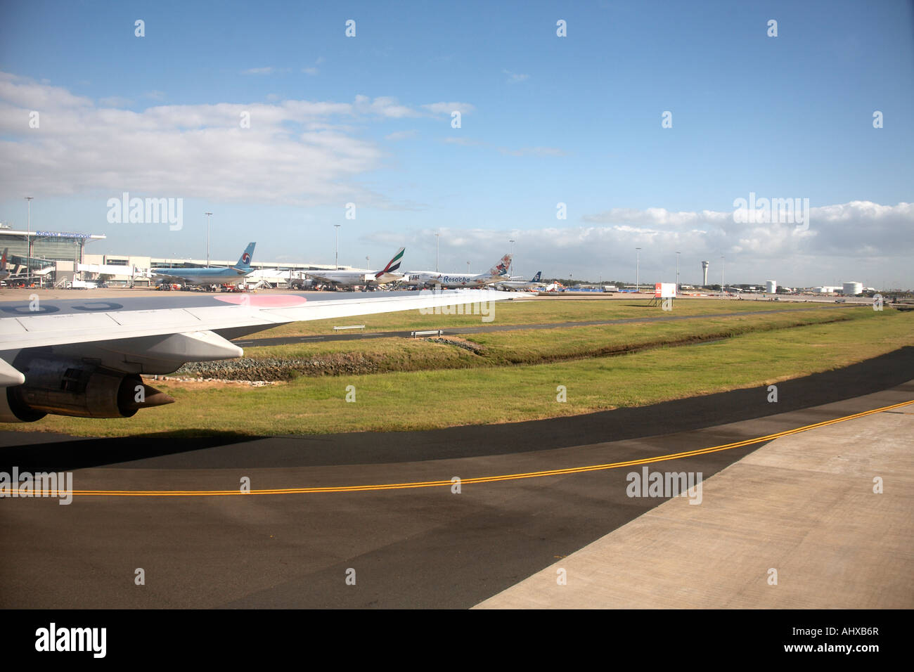 View from window of aircraft taxiing on runway at International Airport in Brisbane Queensland QLD Australia - Stock Image