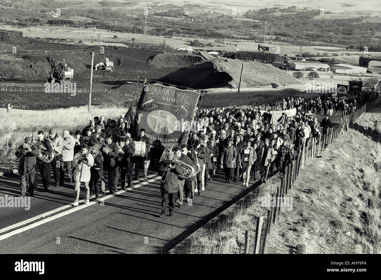 Miners with families and supporters march back to work at Tower Colliery after bought the pit in a co-operative Stock Photo