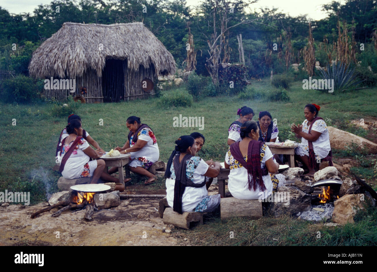 maya-women-cooking-tortillas-over-open-f