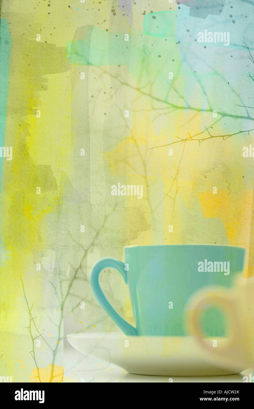 photo illustration of a pair of coffee cups in winter setting with branches - Stock Image