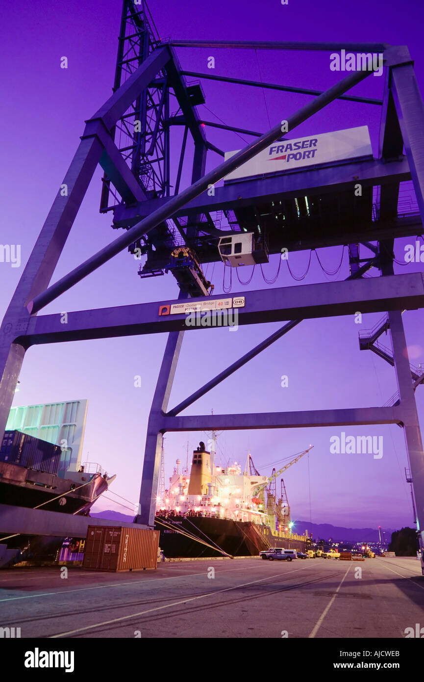 Container cranes and freighter - Stock Image