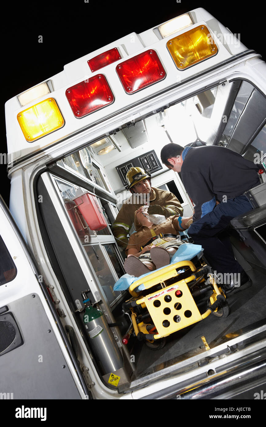 Person receiving medical aid inside ambulance - Stock Image