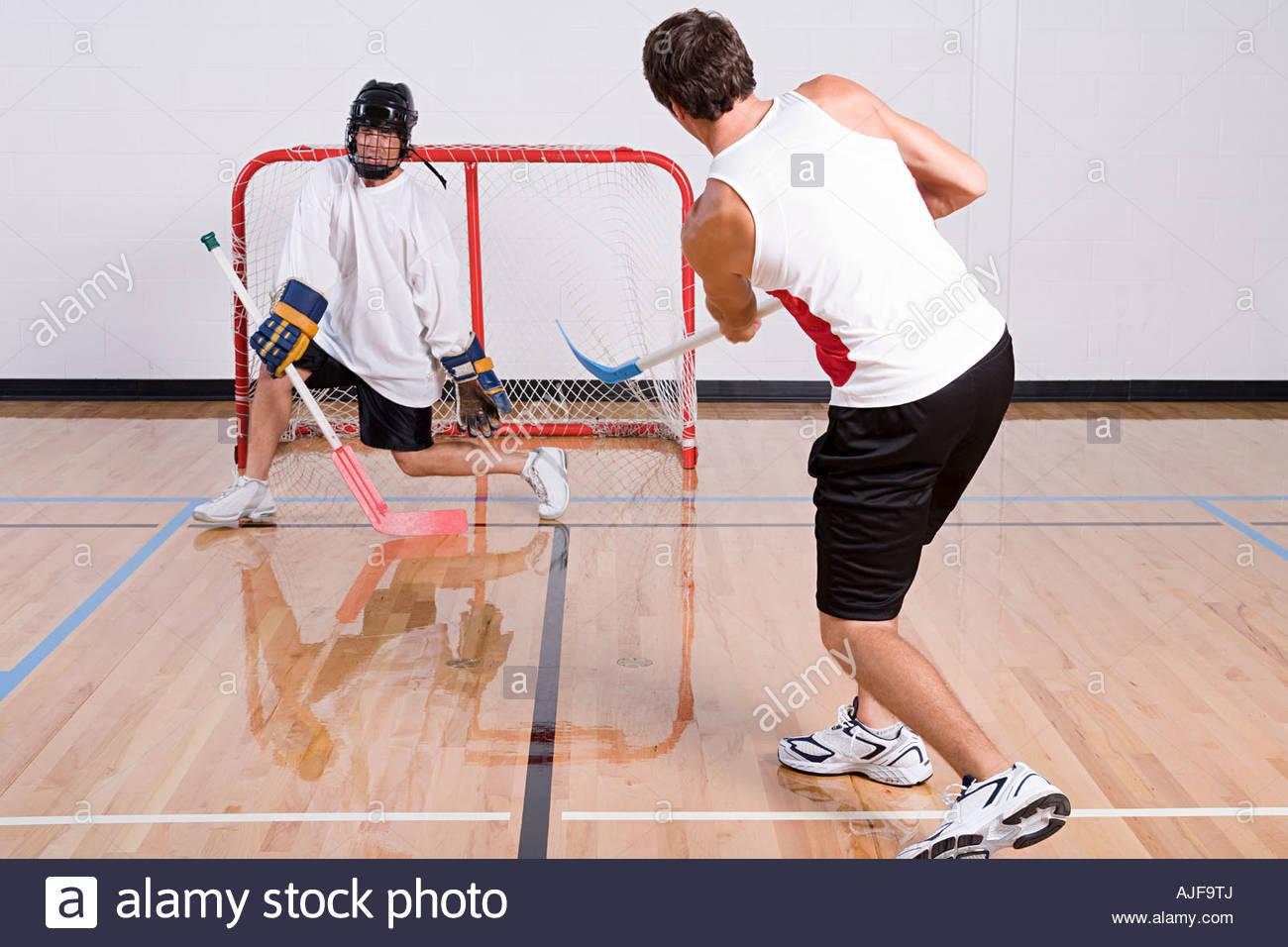 Hockey goalkeeper making a save - Stock Image
