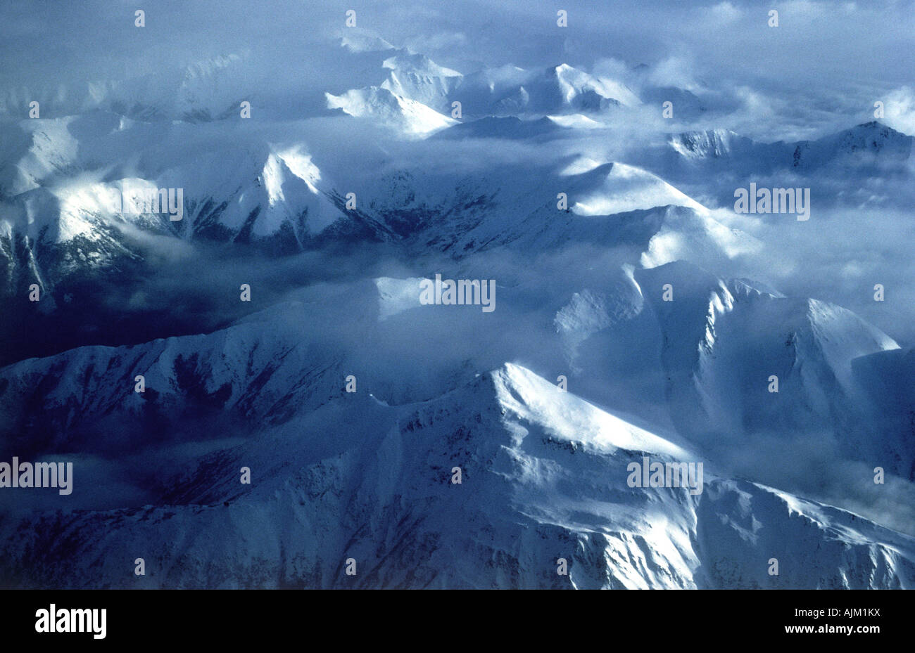 Aerial view of glaciers and mountain ranges near Anchorage, Alaska - Stock Image
