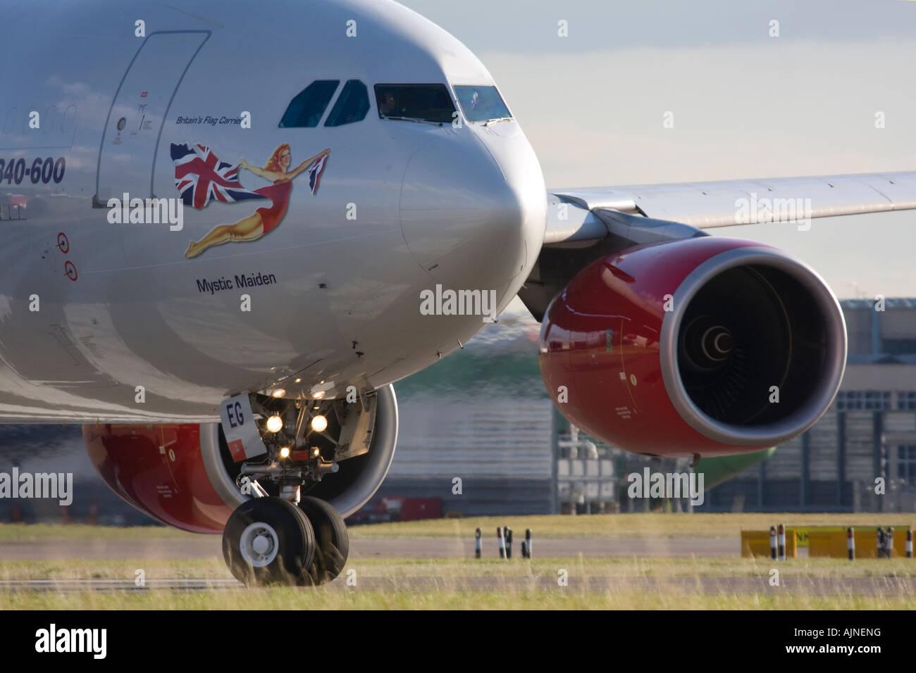 Virgin Atlantic Airways Airbus A340-642 taxiing for departure at London Heathrow Airport, UK - Stock Image