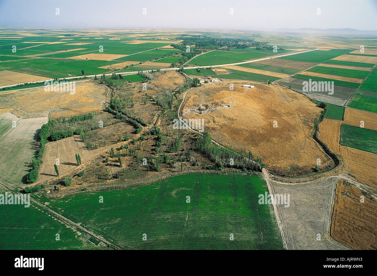 Aerial view of Catalhoyuk tumulus in Cumra, Turkey. Stock Photo