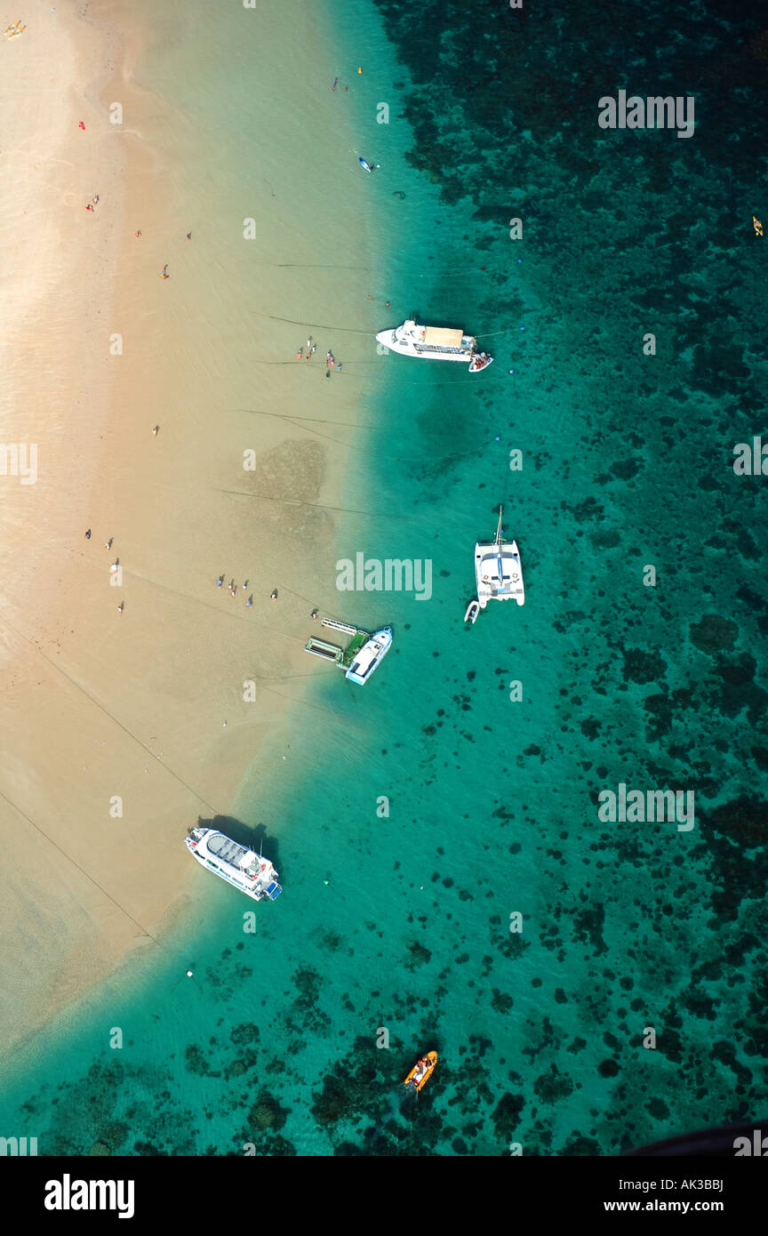 Boats and people and reefs and beach of Coral Bay Ningaloo Reef Marine Park Western Australia Stock Photo