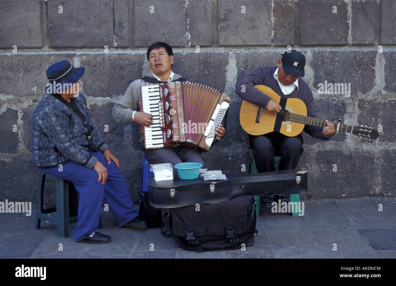 three-street-musicians-performing-in-the