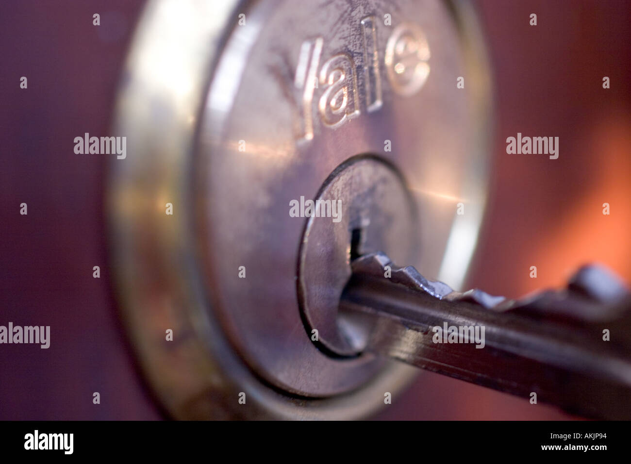 Unlocking locking front door Yale key in Lock & Unlocking locking front door Yale key in Lock Stock Photo: 4902547 ...