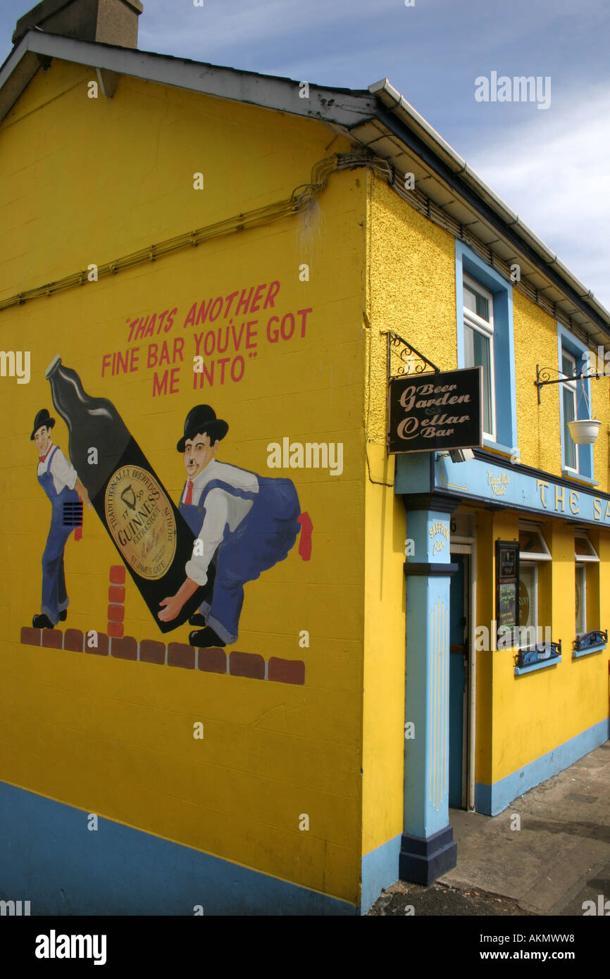 Guinness advert on side wall of pub in Waterfoot, County Antrim ...