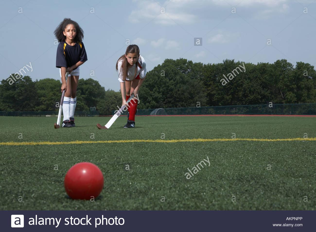 Two girls playing hockey - Stock Image
