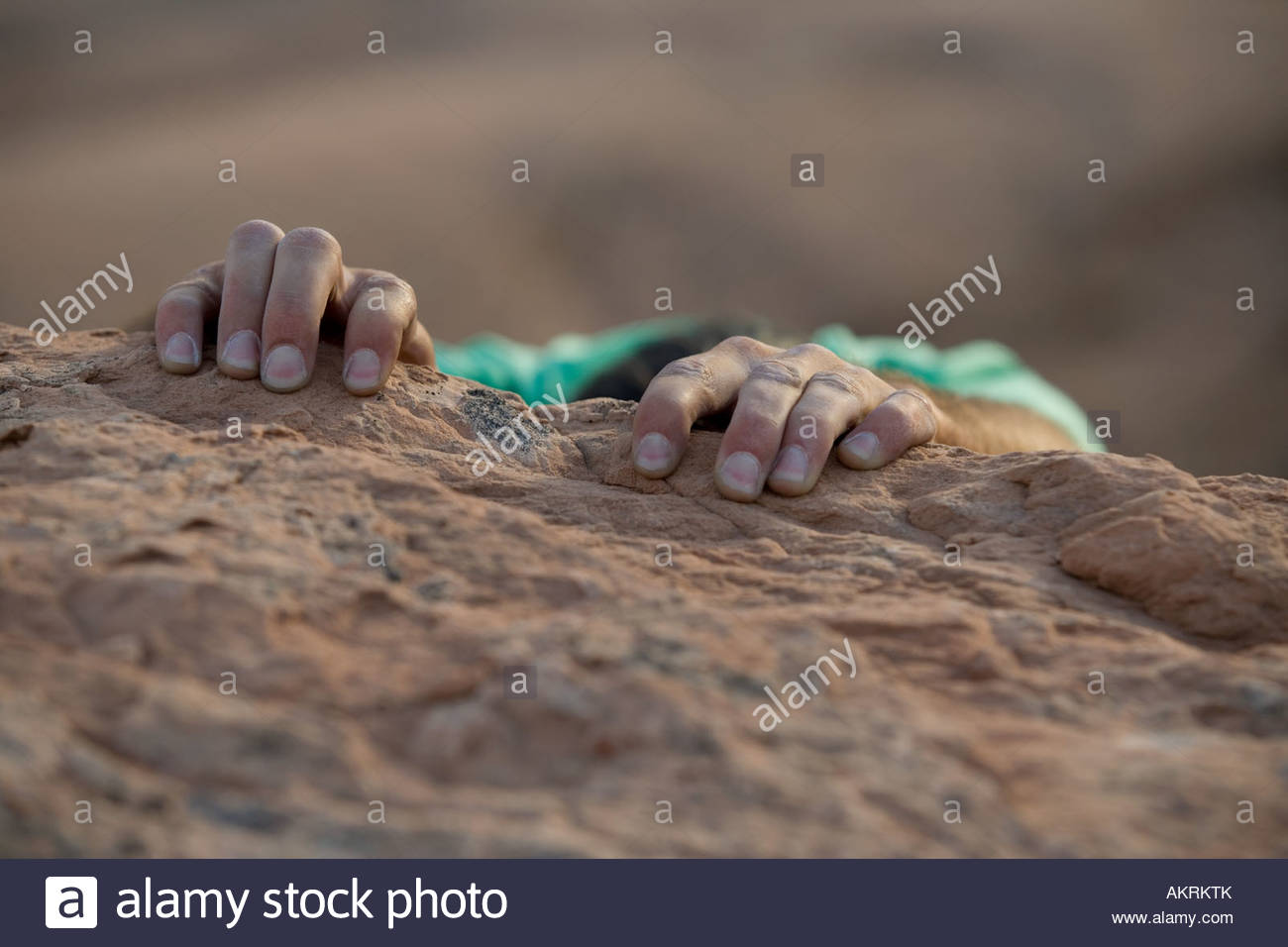 Hands of a rock climber - Stock Image