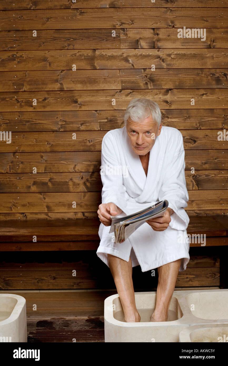 Germany, senior man having foot bath in health spa Stock Photo ...