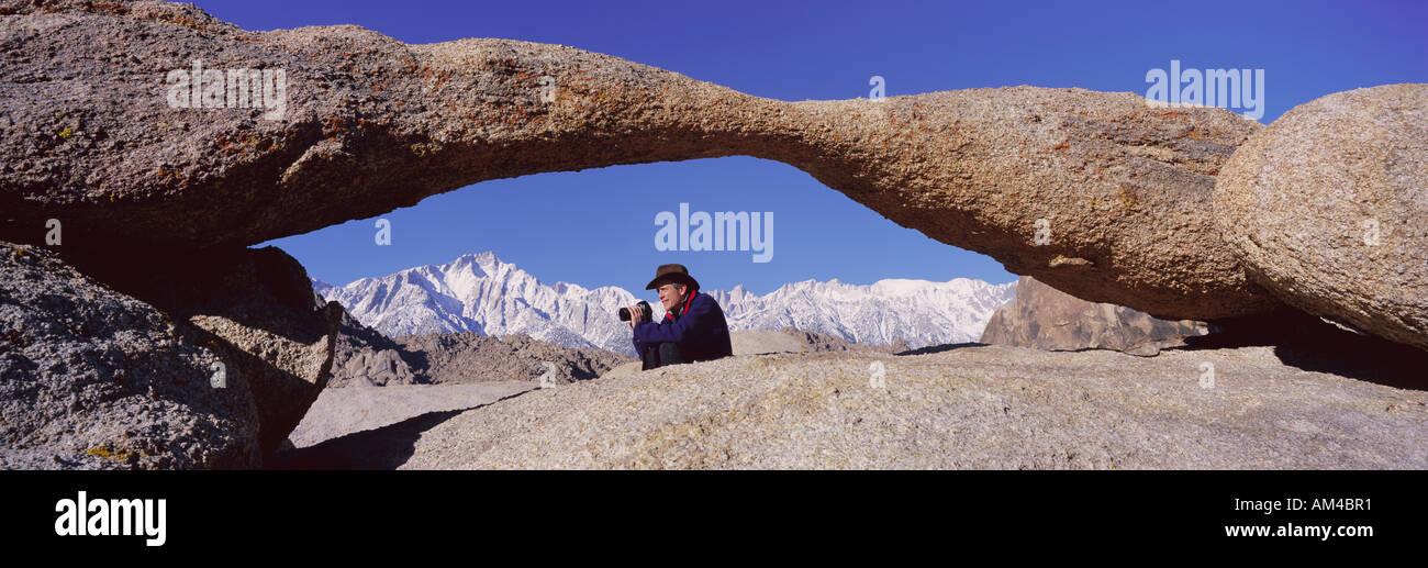 Photographer Joe Sohm With Panoramic Camera Frames Shot Of Mount