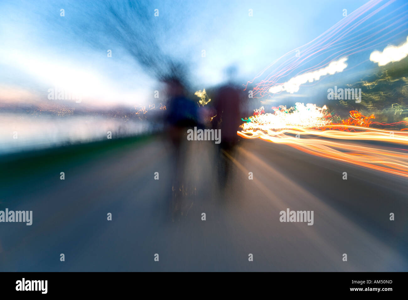 https://c7.alamy.com/comp/AM50ND/extremely-blurred-zooming-effect-image-of-people-walking-of-into-the-AM50ND.jpg