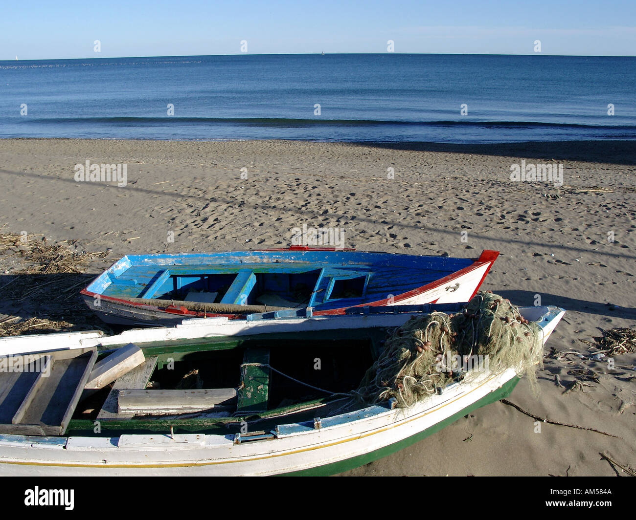 Old Wooden Fishing Boats on the Beach Carvajal beach Fuengirola Spain - Stock Image