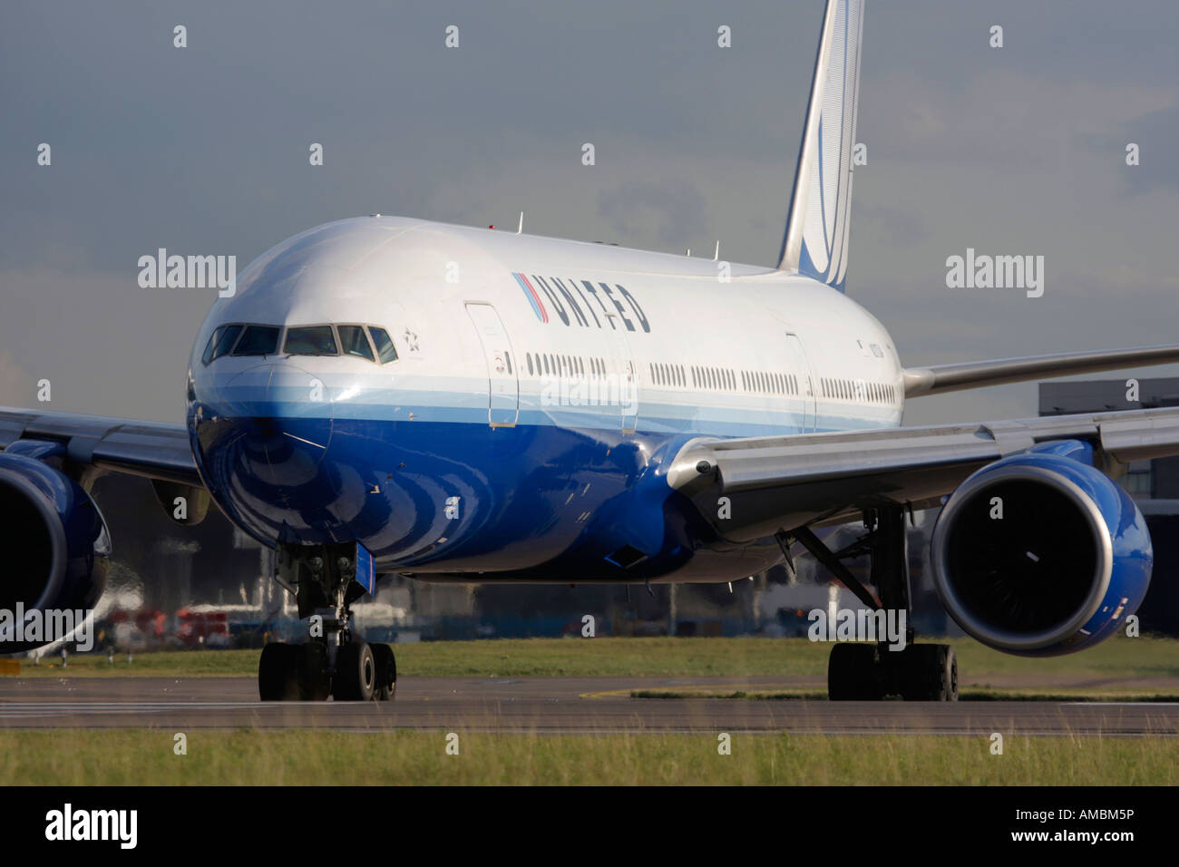 United Airlines Boeing 777 taxiing for departure at Heathrow Airport London UK - Stock Image