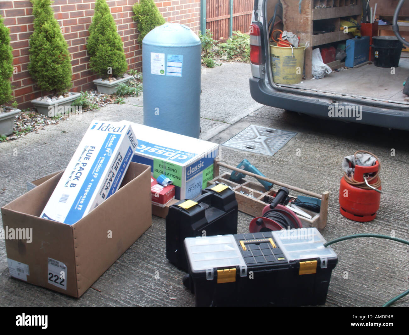 Plumbers van on drive of domestic residence with boxed materials to ...