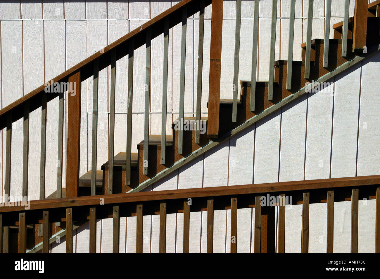Wooden steps on the side of a building - Stock Image