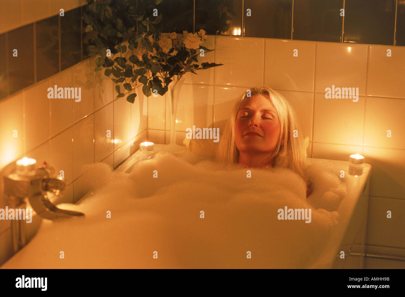 Candle lit bubble bath for relaxed blond woman Stock Photo: 4984218 ...