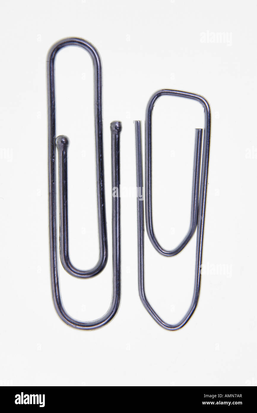 Two paper clips on white background - Stock Image