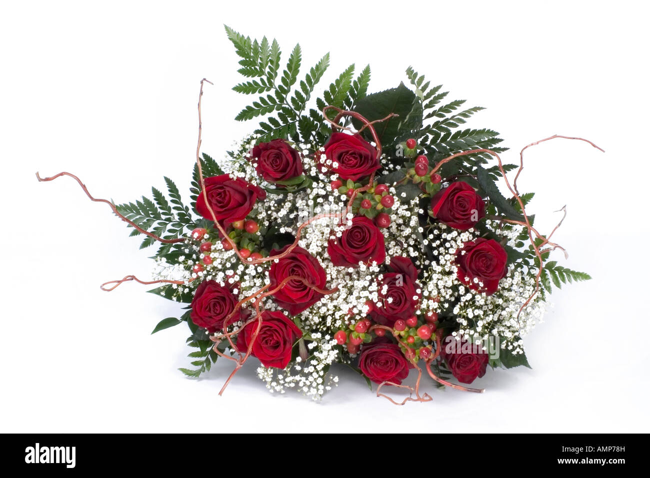 Small Display Of Red Roses White Angels Hair And Ferns Stock Photo