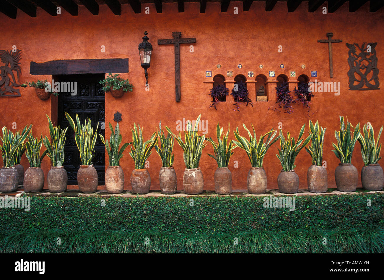 a-decorated-wall-in-the-courtyard-of-the