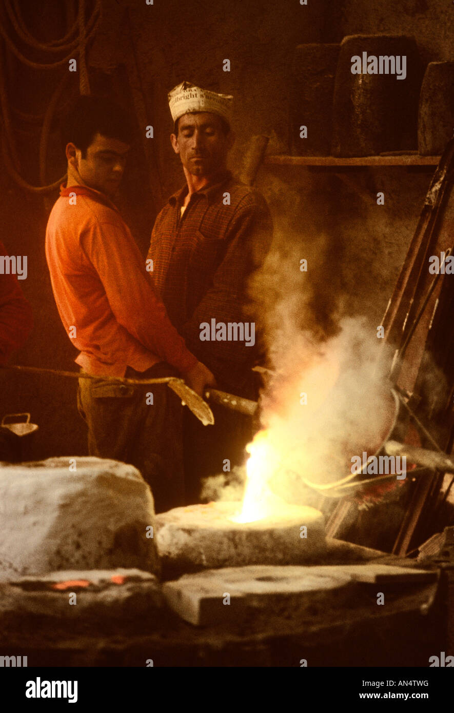 men-pouring-bronze-at-a-foundry-in-rome-
