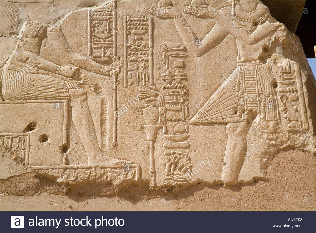 Ancient egyptian bas relief carving in iconic style of