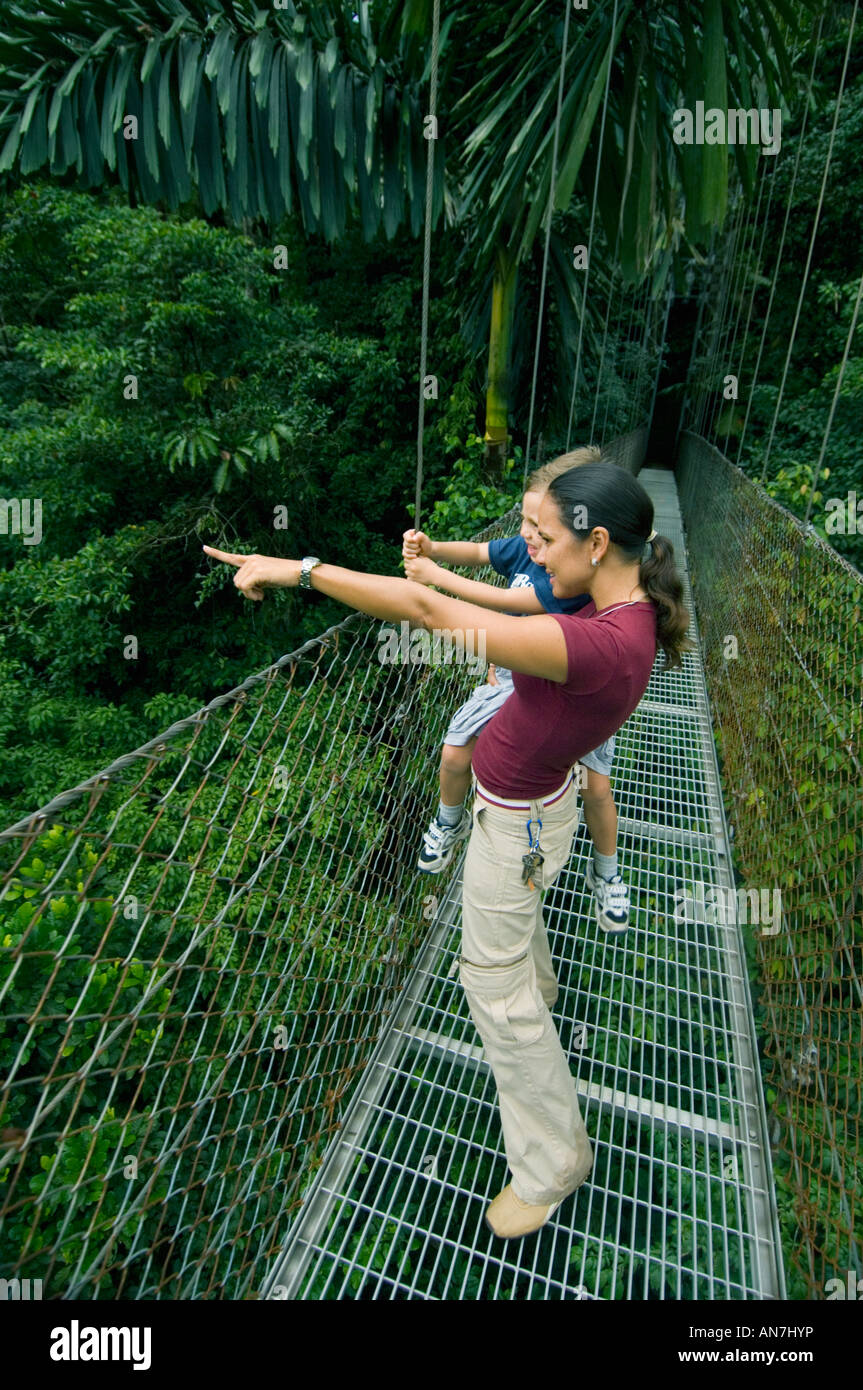 Mother and son on Arenal Hanging Bridges, Costa Rica - Stock Image