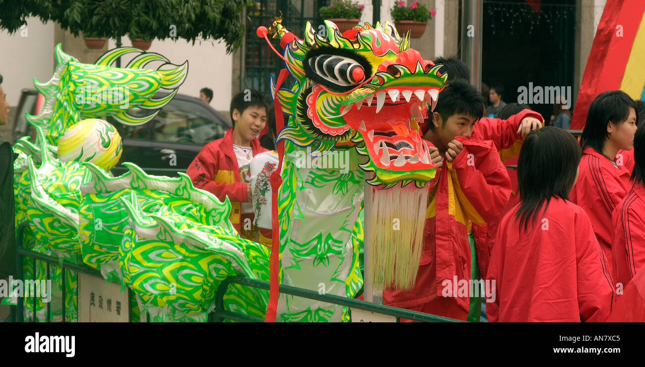 Students prepare dragon for chinese new year celebrations in former portuguese colony of Macau China - Stock Image