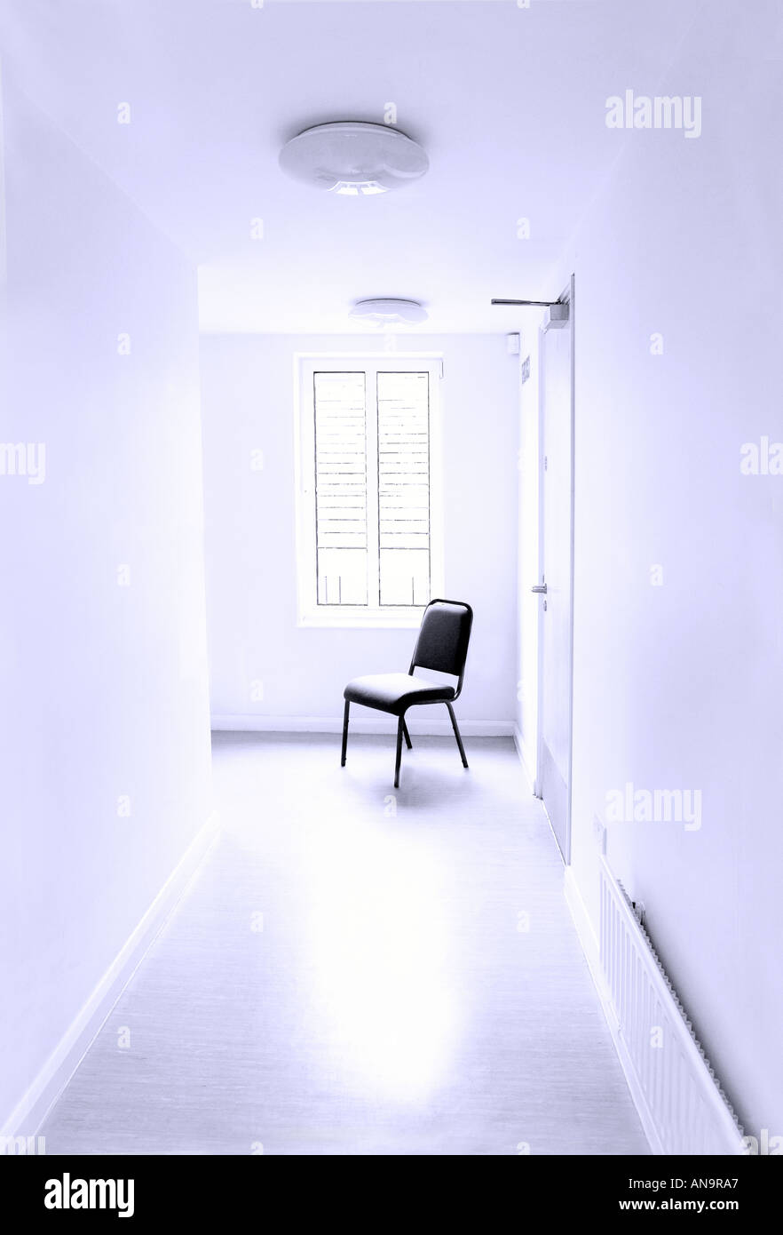 Chair in a very sterile and clean looking white hallway Looks like an asylum of some type or possibly hospital & Chair in a very sterile and clean looking white hallway Looks like ...