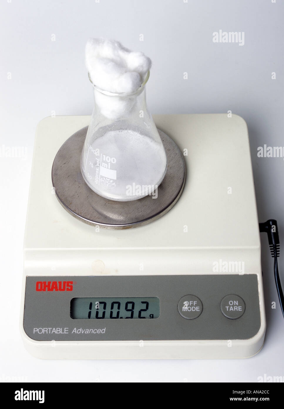 monitoring the change in weight as yeast generates carbon dioxide - Stock Image
