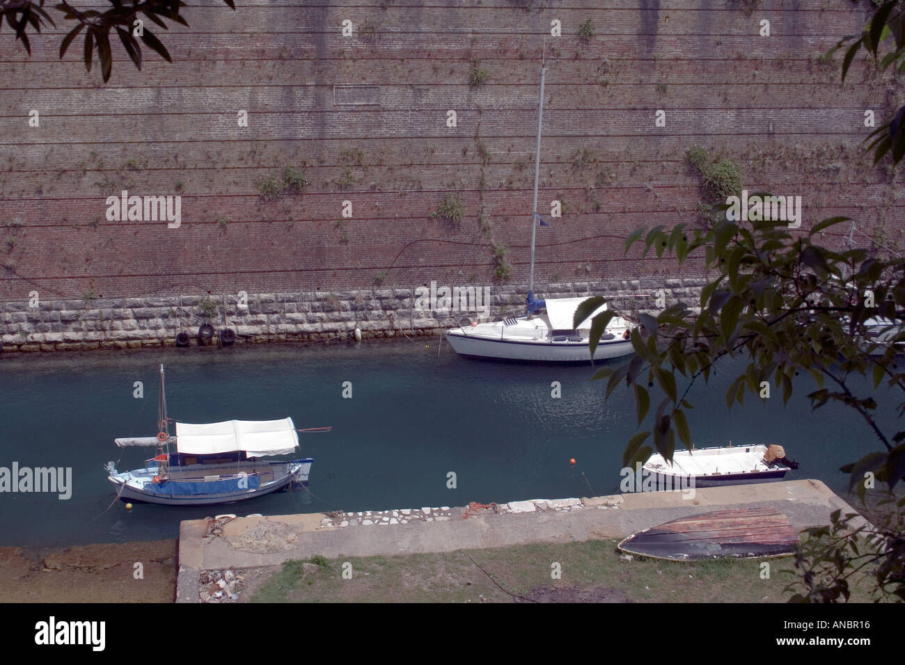 Boats, Contras Fossa moat, Corfu town,  Kerkyra, Greece, - Stock Image