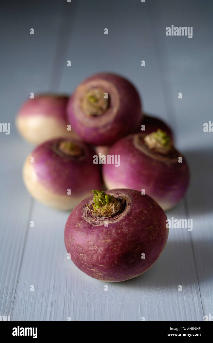 Turnips on blue wooden table - Stock Image