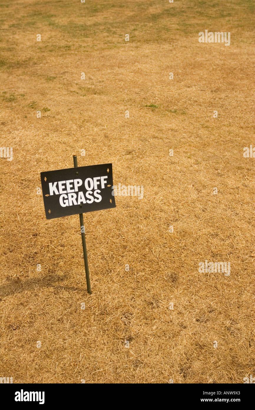 makeshift-keep-off-grass-sign-on-a-piece
