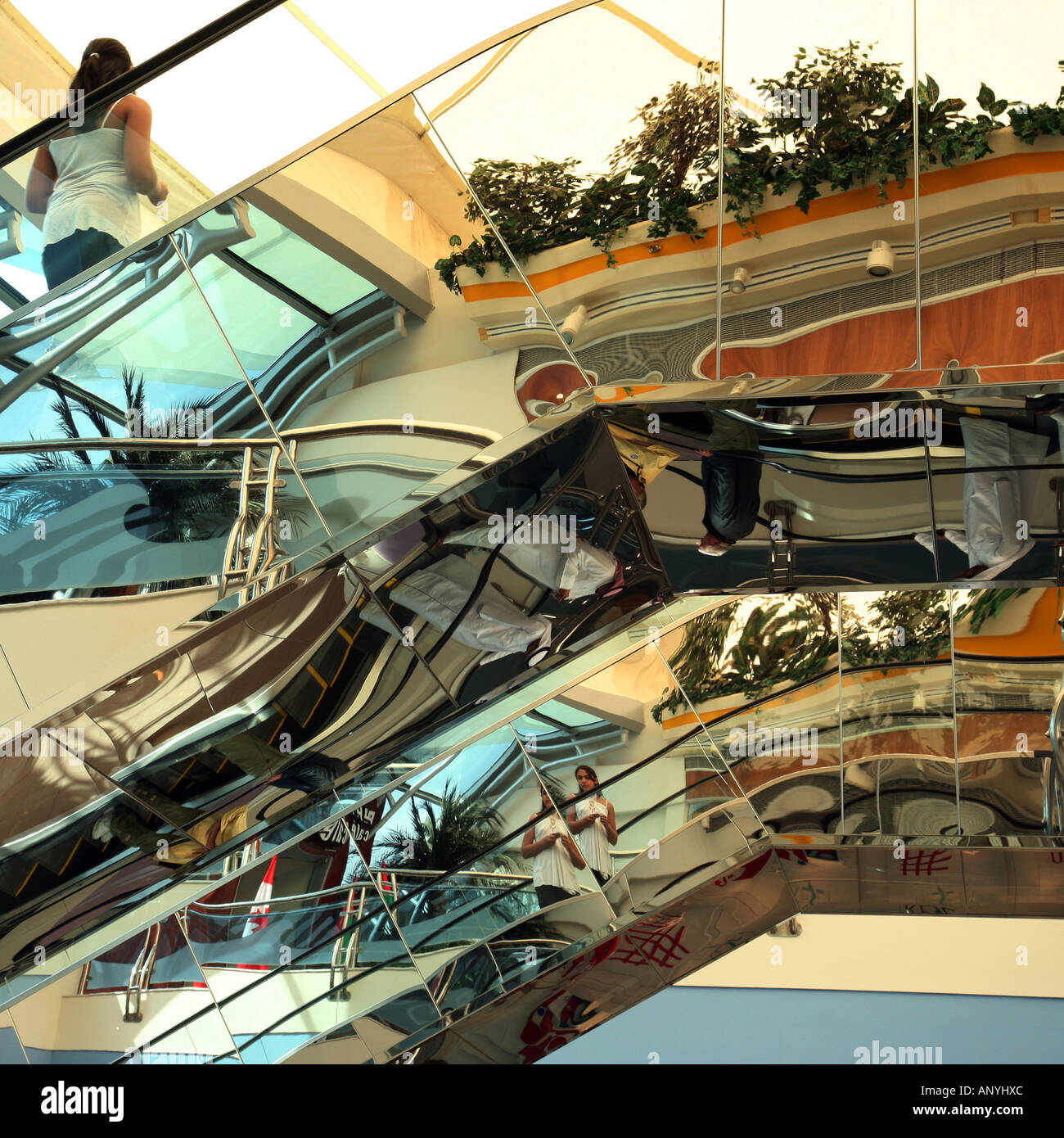 a-young-girl-travels-on-an-escalator-reflected-in-the-stainless-steel-ANYHXC.jpg