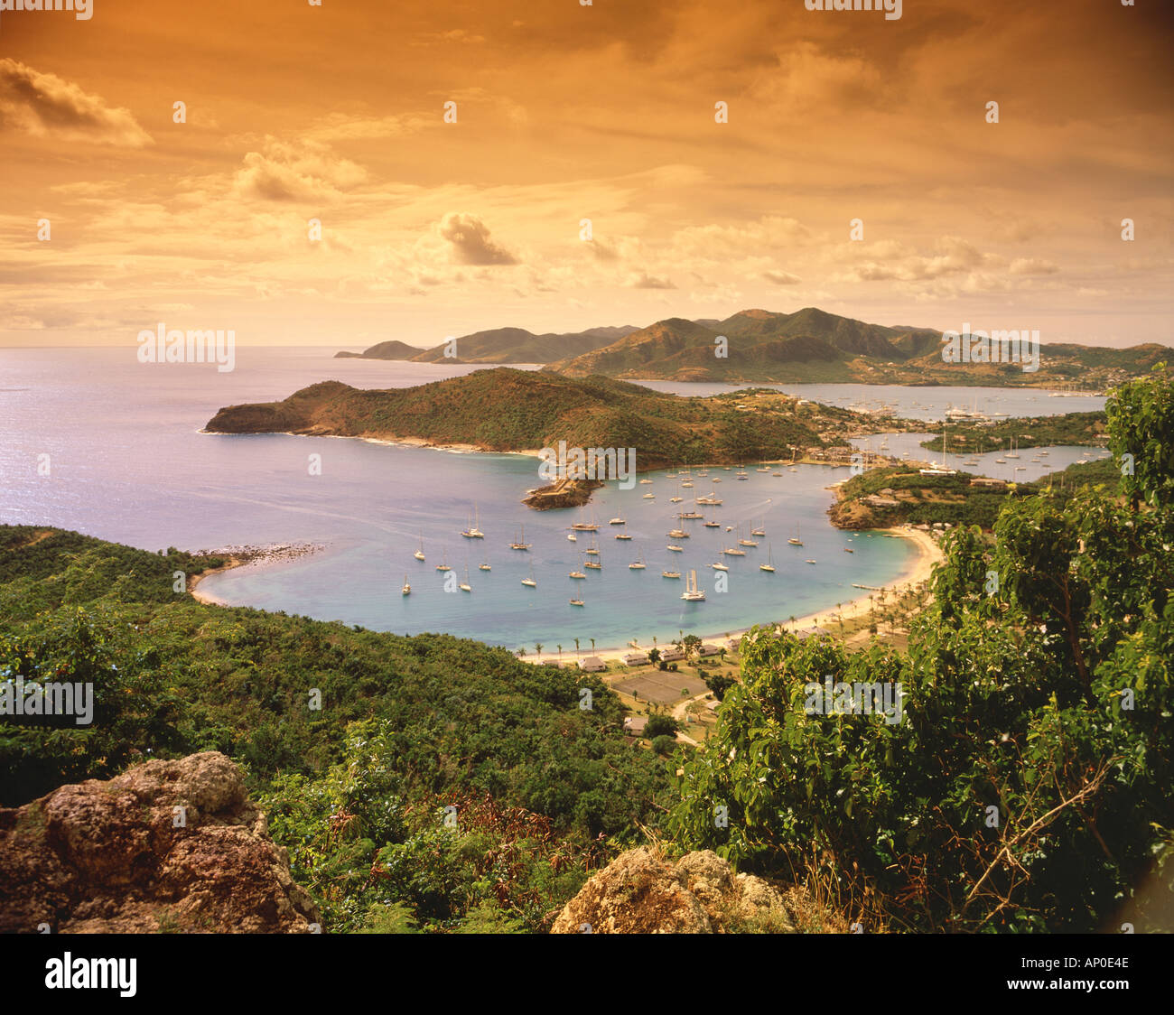Dramatic bird s eye sunset view of Nelson s Dockyard surrounding mountains and coves on the tropical island of Antigua Stock Photo