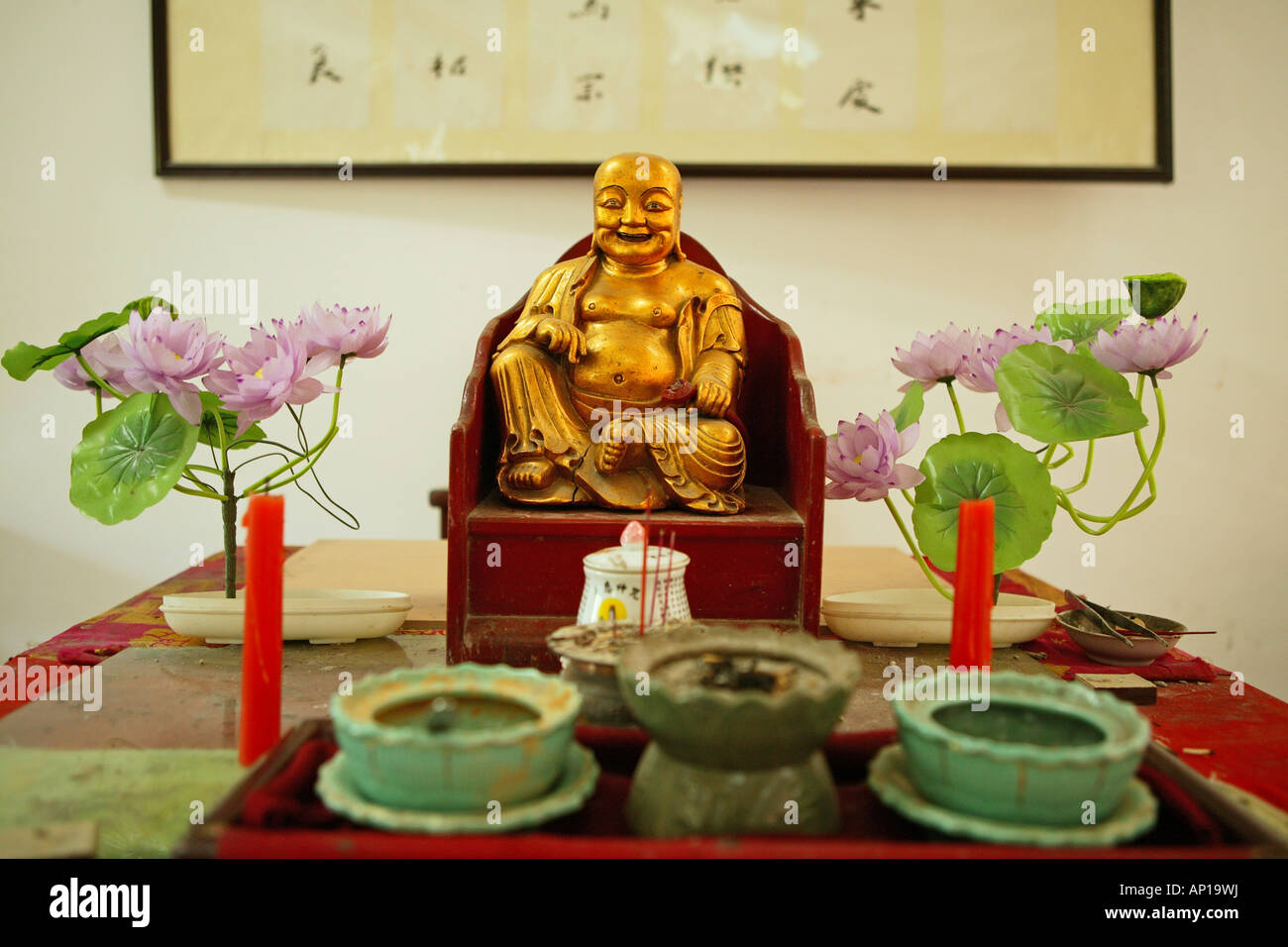 Dining Hall Altar With Buddha Statue And Plastic Lotus Flowers Stock
