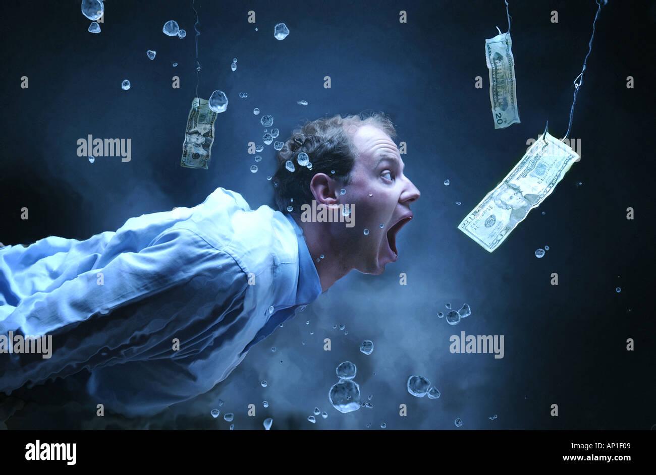 'business humor' concept man swimming underwater after money on fishing hook. Sucker deals. 'High Interest' - Stock Image