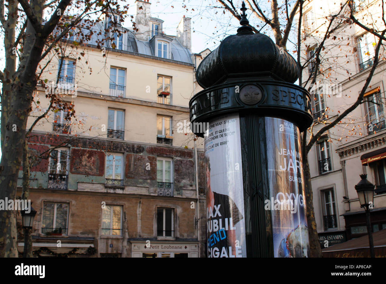 A traditional French advertising bollard on the Left Bank of the River Seine in the Ile de la Cite Paris France - Stock Image