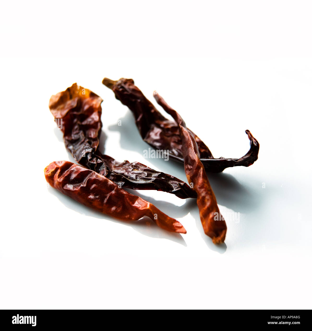 dried-kashmiri-red-chillies-on-white-bac