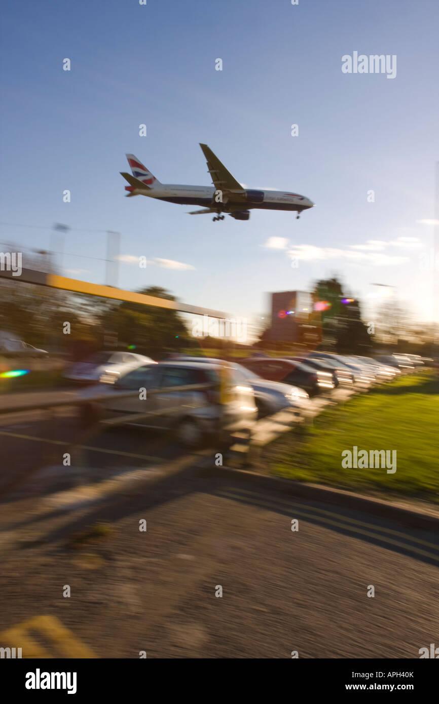 British Airways Boeing 777-236ER coming to land on runway 27L at London Heathrow Airport UK - Stock Image
