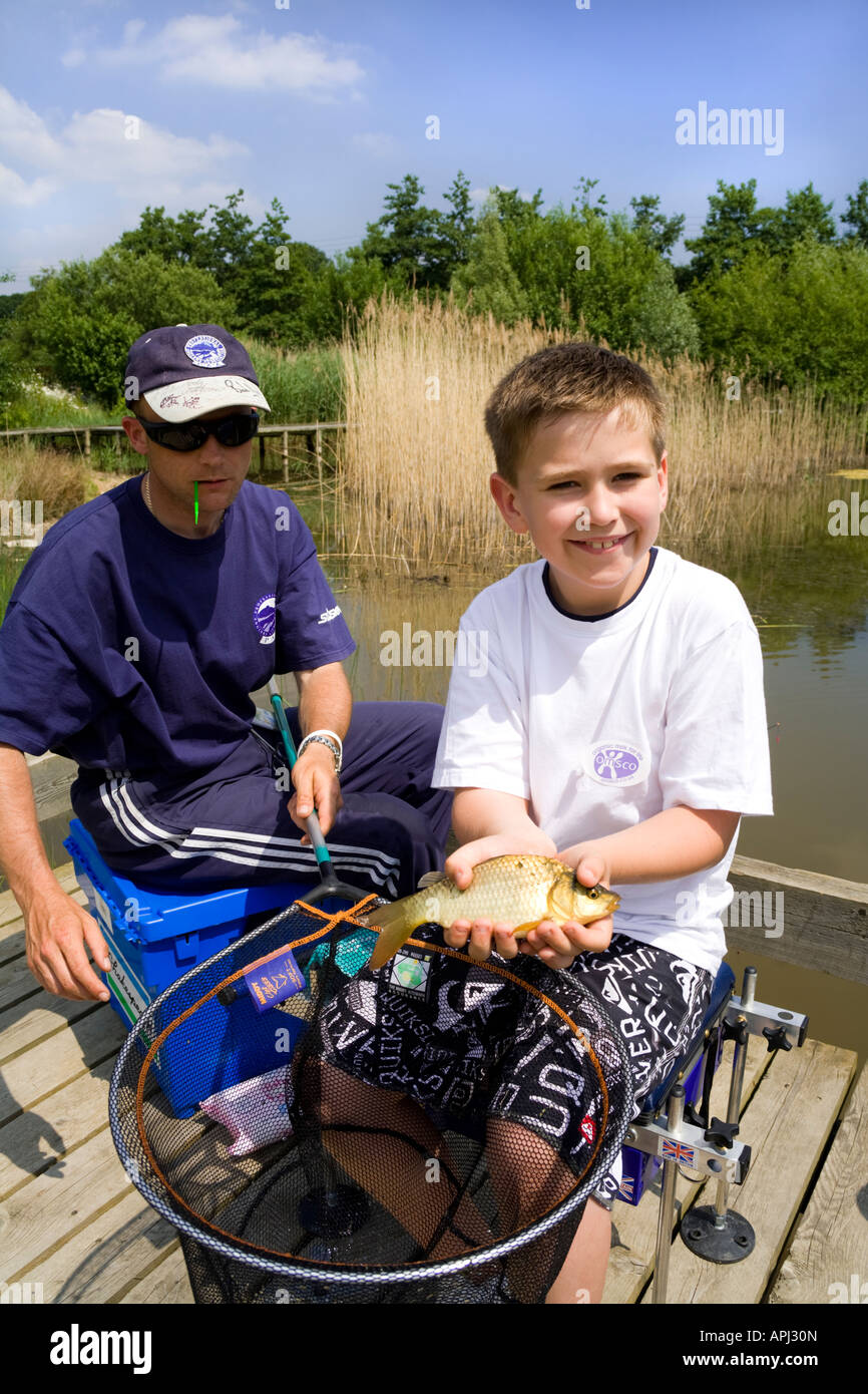 PAA coach giving angling instruction to a lad at the Three Counties Show, Malvern, Worcestershire - Stock Image