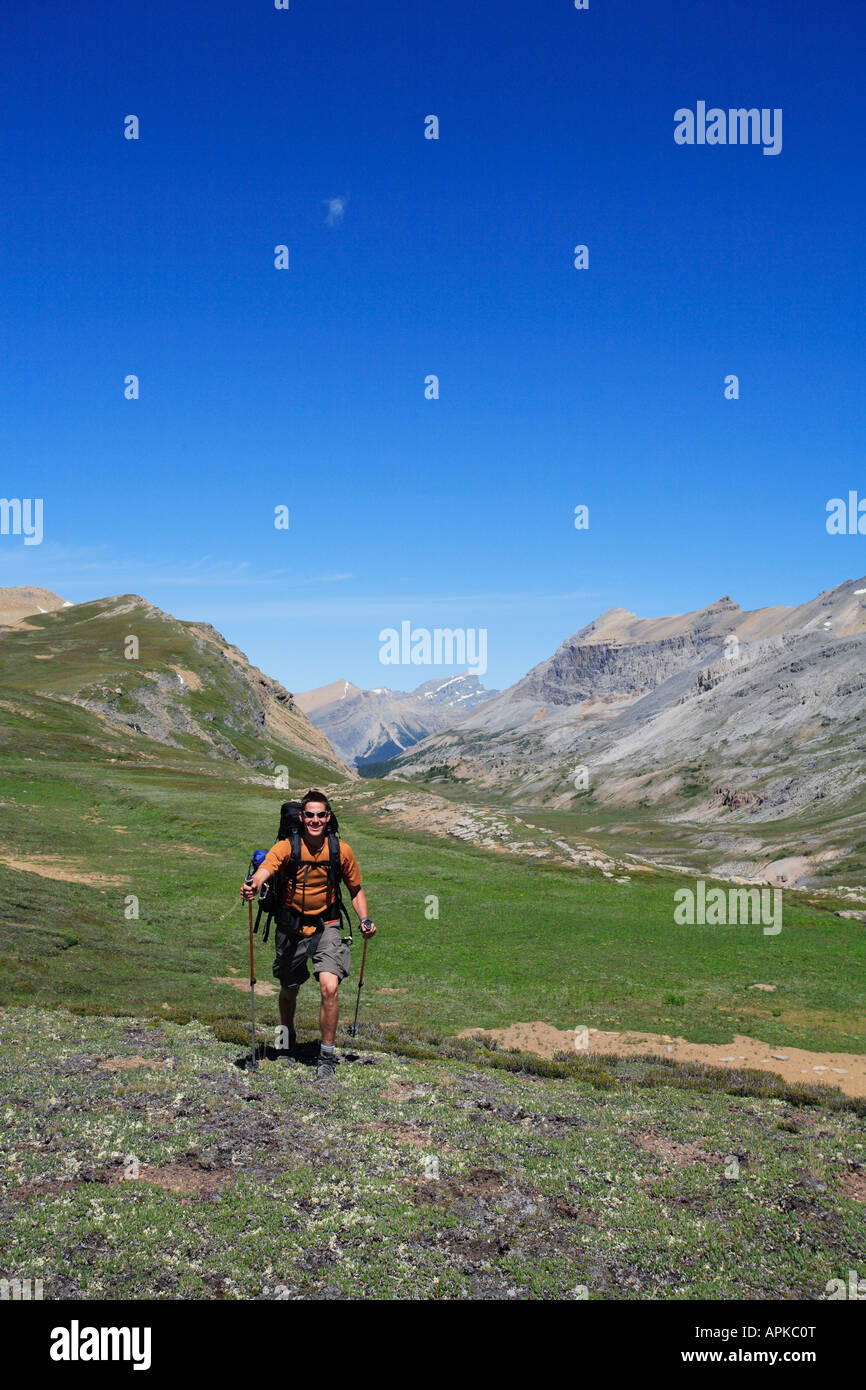 Man backpacking or trekking in Banff National Park - Stock Image