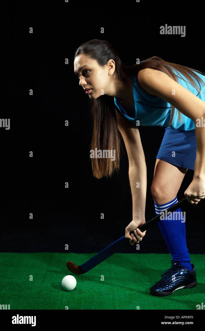 Feminine hockey player - Stock Image