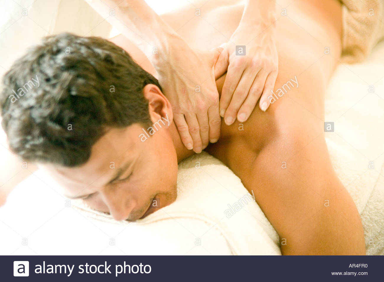 A young man receives a massage at the spaStock Photo